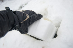 Build your own snow igloo - inserting brick